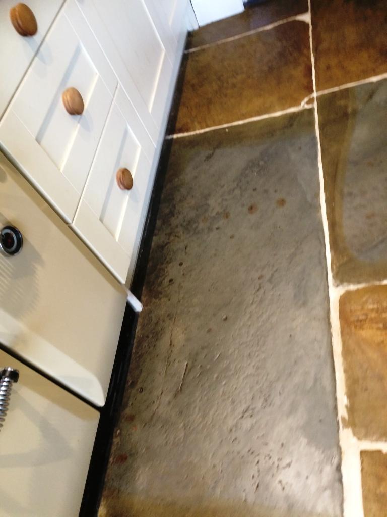 Old Flagstone Tiled Kitchen Floor After Renovation in Stacksteads Backup